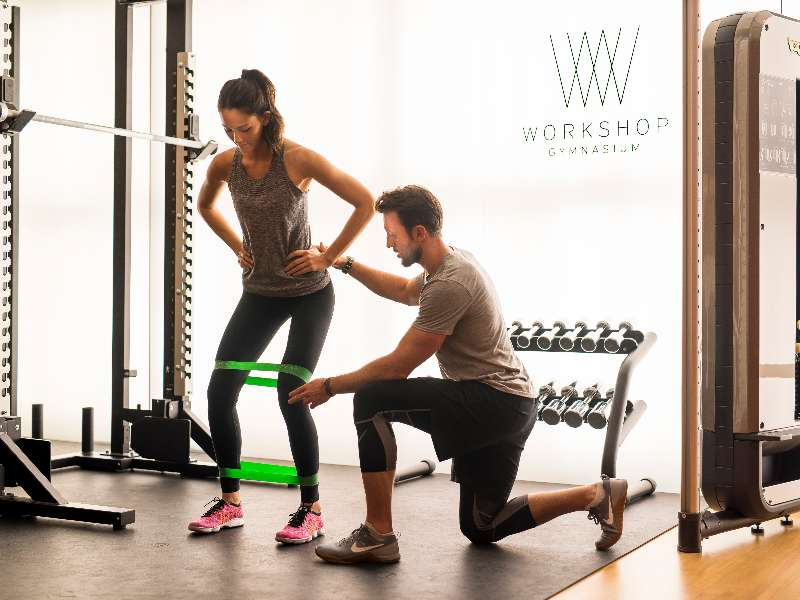A girl training with one of the personal trainer of the Workshop Gymnasium at The Bvlgari Hotel London