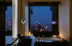 The bathroom of a room by night at The Bvlgari Hotel Shanghai